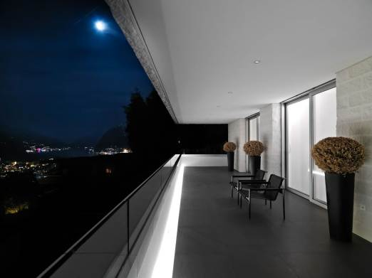 Residence-Balcony-Euipped-With-Black-Chairs-And-Brown-Plants-